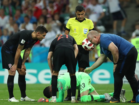 epa06872581 Goalkeeper Danijel Subasic of Croatia receives medical treatment during the FIFA World Cup 2018 quarter final soccer match between Russia and Croatia in Sochi, Russia, 07 July 2018.  (RESTRICTIONS APPLY: Editorial Use Only, not used in association with any commercial entity - Images must not be used in any form of alert service or push service of any kind including via mobile alert services, downloads to mobile devices or MMS messaging - Images must appear as still images and must not emulate match action video footage - No alteration is made to, and no text or image is superimposed over, any published image which: (a) intentionally obscures or removes a sponsor identification image; or (b) adds or overlays the commercial identification of any third party which is not officially associated with the FIFA World Cup)  EPA/MOHAMED MESSARA   EDITORIAL USE ONLY