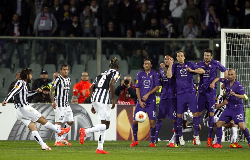 Juventus' Andrea Pirlo, left, scores during an Europa League, round of 16, return-leg soccer match between Fiorentina and Juventus, at the Artemio Franchi stadium in Florence, Italy, Thursday, March 20,, 2014. (AP Photo/Fabrizio Giovannozzi)