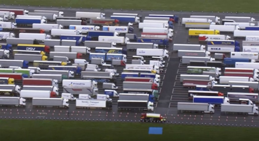Trucks are parked in a holding area, in this aerial photo taken from video, lined up at former airfield in Manston, England, close to the M20 highway that runs to the port of Dover, Britain's main ferry connection with mainland Europe in northern France, Tuesday Dec. 22, 2020. The goods trucks are waiting to get out of Britain as France barred travel from the UK for 48 hours because of a new and seemingly more contagious strain of the coronavirus in England. (Sky via AP)