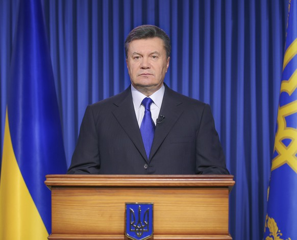 """Ukraine's President Viktor Yanukovich makes a statement in Kiev February 19, 2014. Yanukovich urged leaders of the opposition on Wednesday to dissociate themselves from radicals and warned them that otherwise he will """"talk differently"""" with them. Yanukovich also said in a statement some members of the anti-government opposition had crossed a line when they called on their supporters to bring weapons to the demonstration in the central square of Ukraine's capital, Kiev. REUTERS/Ukraine's Presidential Press Service/Handout via Reuters (UKRAINE - Tags: POLITICS)   ATTENTION EDITORS - THIS IMAGE WAS PROVIDED BY A THIRD PARTY. FOR EDITORIAL USE ONLY. NOT FOR SALE FOR MARKETING OR ADVERTISING CAMPAIGNS. THIS PICTURE IS DISTRIBUTED EXACTLY AS RECEIVED BY REUTERS, AS A SERVICE TO CLIENTS"""