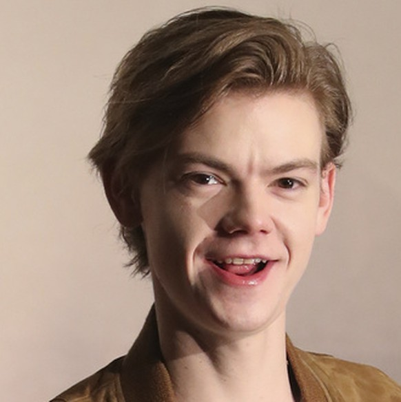Actor Thomas Brodie-Sangster poses for the media after a press conference for the movie
