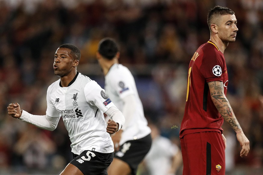 epa06707500 Liverpool's Georgino Wijnaldum (L) celebrates after scoring the 2-1 lead next to Roma's Aleksandar Kolarov (R) during the UEFA Champions League semi final, second leg soccer match between AS Roma and Liverpool FC at the Olimpico stadium in Rome, Italy, 02 May 2018.  EPA/RICCARDO ANTIMIANI