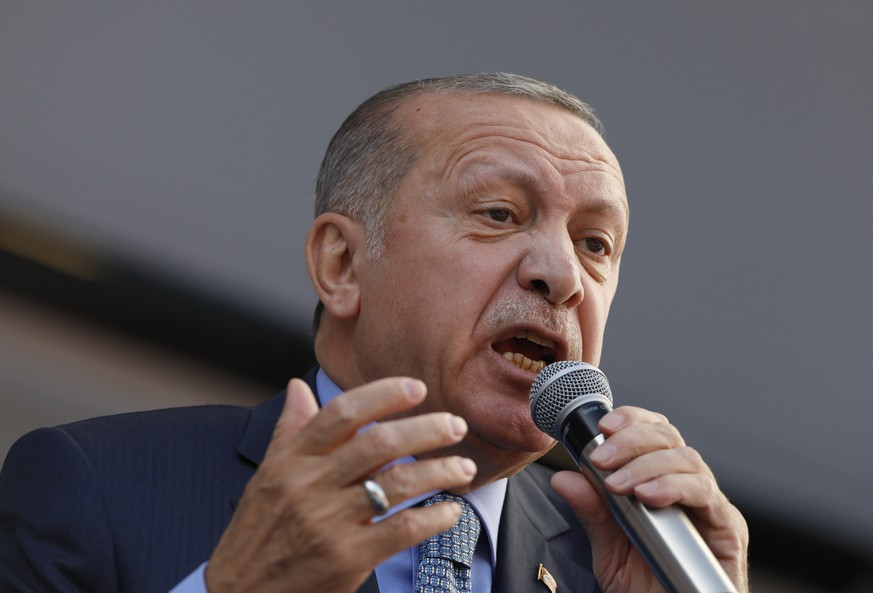 Turkey's President Recep Tayyip Erdogan addresses the supporters of his ruling Justice and Development Party, AKP, during a rally in Ankara, Turkey, Thursday, March 14, 2019. Continuing an exchange of words with the Israeli prime minister, Erdogan says Benjamin Netanyahu is