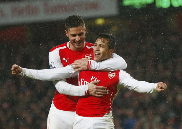 Arsenal's Alexis Sanchez (FRONT) celebrates with team-mate Olivier Giroud after scoring a goal against Queens Park Rangers during their English Premier League soccer match at the Emirates Stadium in London December 26, 2014.       REUTERS/Eddie Keogh (BRITAIN  - Tags: SPORT SOCCER) FOR EDITORIAL USE ONLY. NOT FOR SALE FOR MARKETING OR ADVERTISING CAMPAIGNS. EDITORIAL USE ONLY. NO USE WITH UNAUTHORIZED AUDIO, VIDEO, DATA, FIXTURE LISTS, CLUB/LEAGUE LOGOS OR 'LIVE' SERVICES. ONLINE IN-MATCH USE LIMITED TO 45 IMAGES, NO VIDEO EMULATION. NO USE IN BETTING, GAMES OR SINGLE CLUB/LEAGUE/PLAYER PUBLICATIONS.