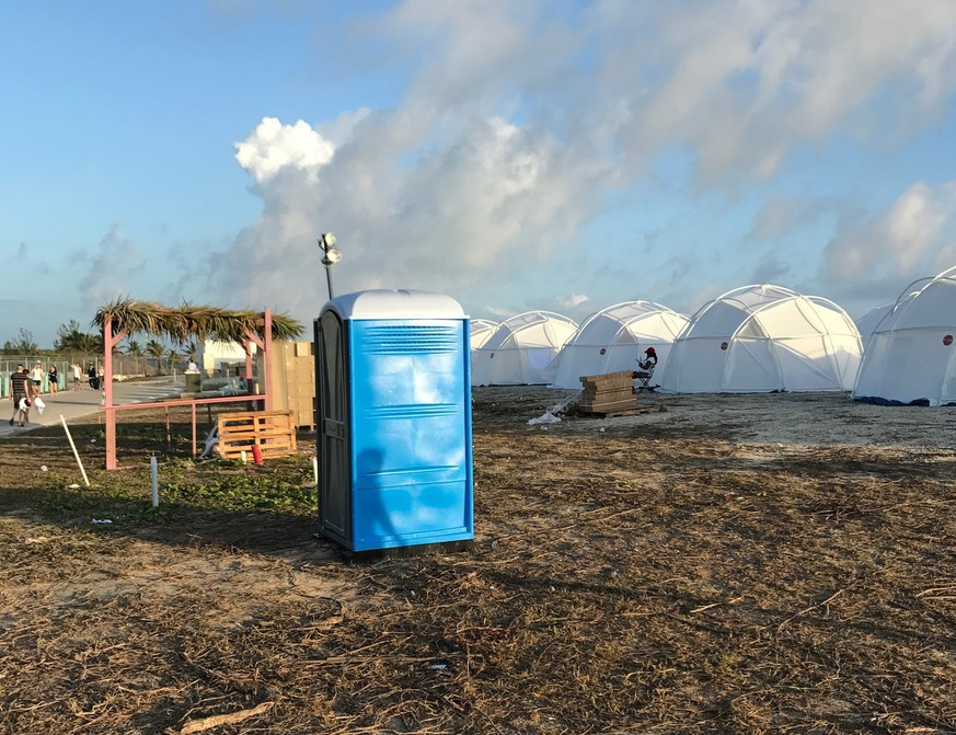 This photo provided by Jake Strang shows tents and a portable toilet set up for attendees for the Fyre Festival, Friday, April 28, 2017 in the Exuma islands, Bahamas. Organizers of the much-hyped music festival in the Bahamas canceled the weekend event at the last minute Friday after many people had already arrived and spent thousands of dollars on tickets and travel. A statement cited