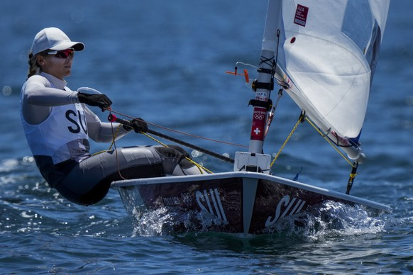 Switzerland's Maud Jayet compete during the Laser radial race 1 at the Enoshima harbour during the 2020 Summer Olympics, Sunday, July 25, 2021, in Fujisawa, Japan. (AP Photo/Bernat Armangue)