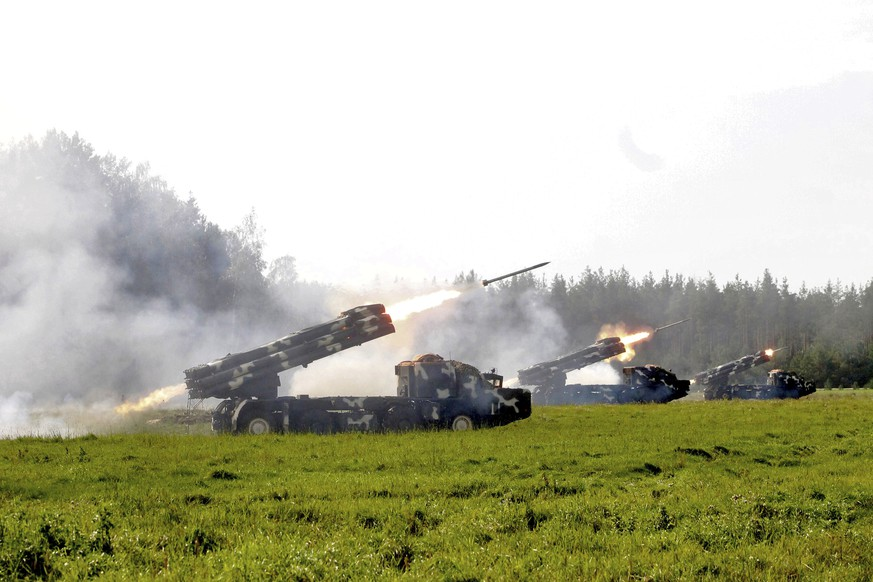 In this Sunday, Sept. 17, 2017, photo provided Monday, Sept. 18, by Vayar Military Agency, Belarus army missile systems fire during a military exercise at an undisclosed location in Belarus. Russia and Belarus began a major war games operation practicing joint military manoeuvres Thursday, reportedly involving thousands of troops, tanks and aircraft on NATO's eastern fringes. (Vayar Military Agency photo via AP)