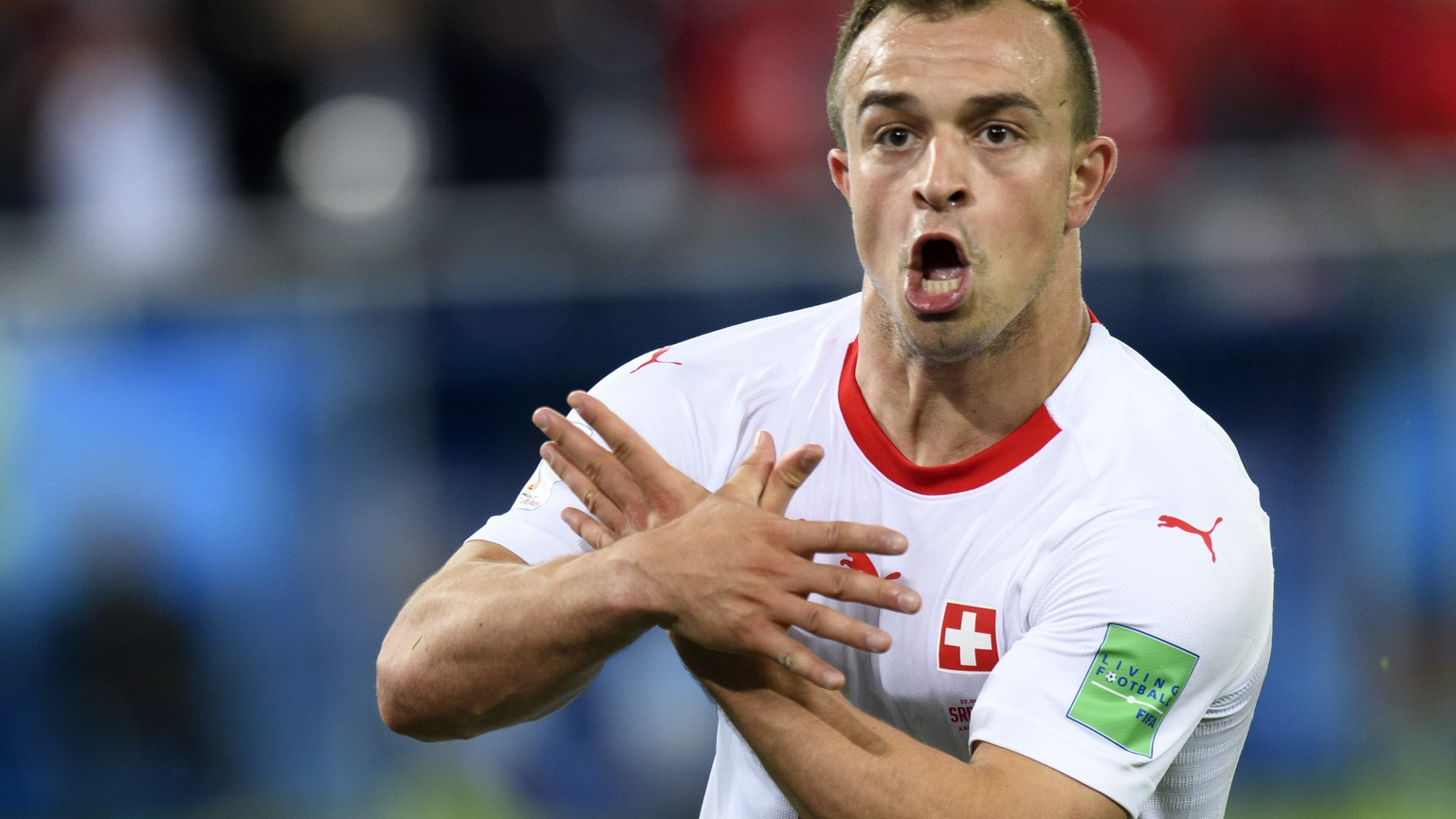 epa06832045 Switzerland's midfielder Xherdan Shaqiri celebrates after scoring the winning goal during the FIFA World Cup 2018 group E preliminary round soccer match between Switzerland and Serbia in Kaliningrad, Russia, 22 June 2018. Switzerland won 2-1.  (RESTRICTIONS APPLY: Editorial Use Only, not used in association with any commercial entity - Images must not be used in any form of alert service or push service of any kind including via mobile alert services, downloads to mobile devices or MMS messaging - Images must appear as still images and must not emulate match action video footage - No alteration is made to, and no text or image is superimposed over, any published image which: (a) intentionally obscures or removes a sponsor identification image; or (b) adds or overlays the commercial identification of any third party which is not officially associated with the FIFA World Cup)  EPA/LAURENT GILLIERON   EDITORIAL USE ONLY