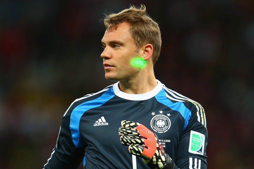PORTO ALEGRE, BRAZIL - JUNE 30:  A laser is shone on Manuel Neuer of Germany during the 2014 FIFA World Cup Brazil Round of 16 match between Germany and Algeria at Estadio Beira-Rio on June 30, 2014 in Porto Alegre, Brazil.  (Photo by Julian Finney/Getty Images)