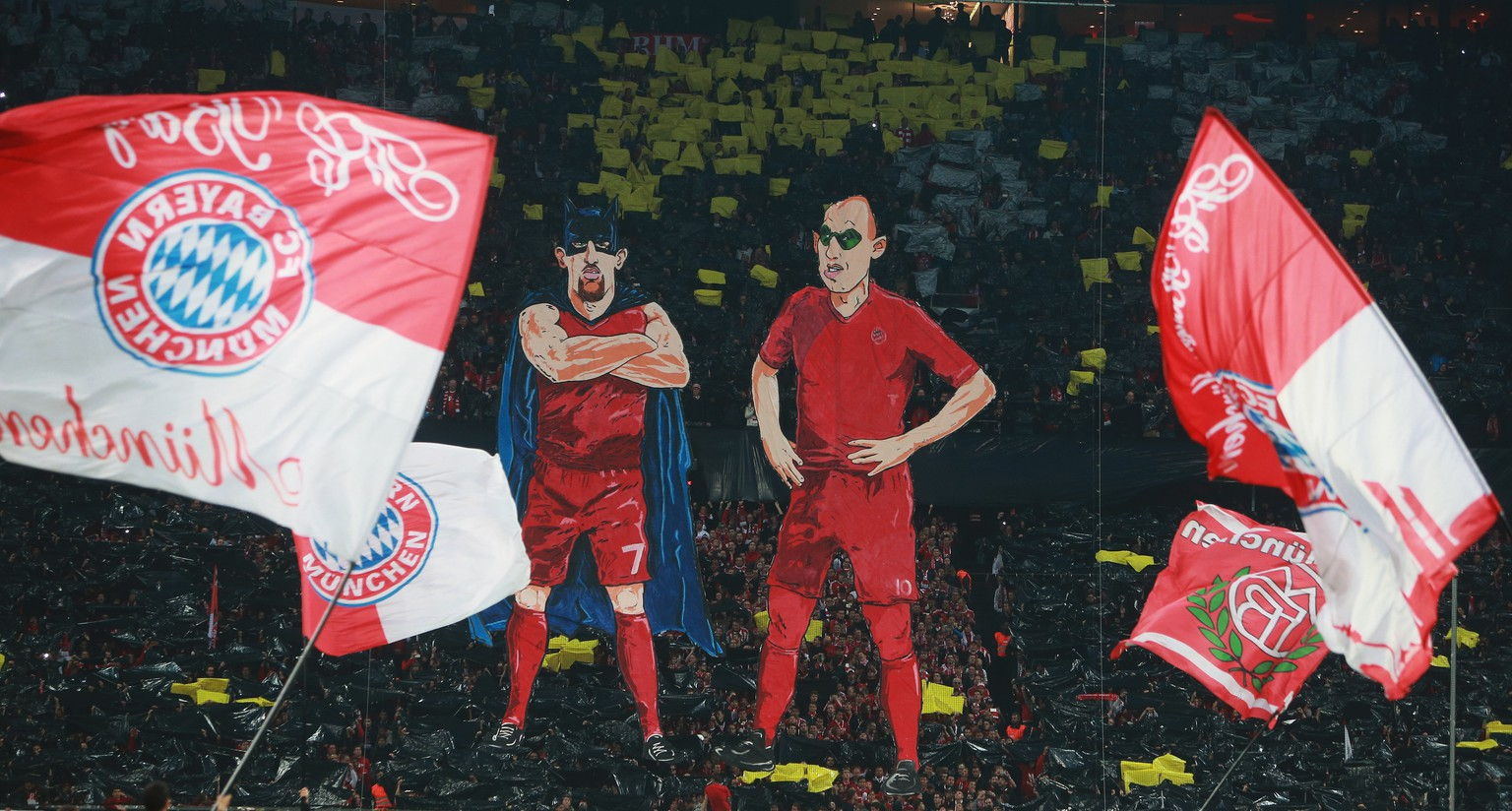 MUNICH, GERMANY - APRIL 28:  e fans of Bayern Muenchen make character figures of Franck Ribery and Arjen Robben as batman and robin prior to the start of the DFB Cup semi final match between FC Bayern Muenchen and Borussia Dortmund at Allianz Arena on April 28, 2015 in Munich, Germany.  (Photo by Alex Grimm/Bongarts/Getty Images)