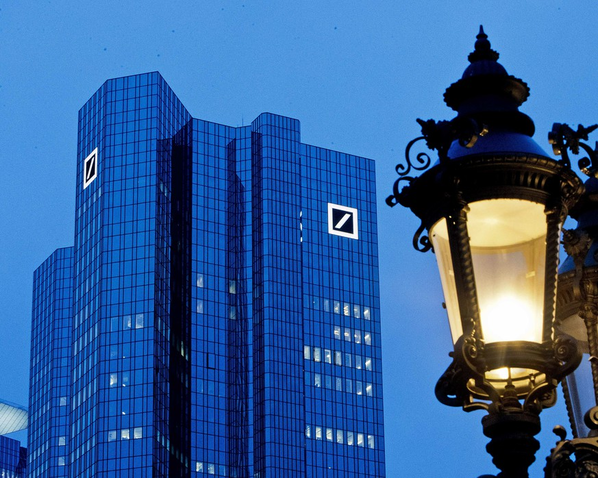 The Deutsche Bank headquarters is seen behind a lamp ahead of the annual press conference in Frankfurt, Germany, Friday, Feb. 1, 2019. (AP Photo/Michael Probst)