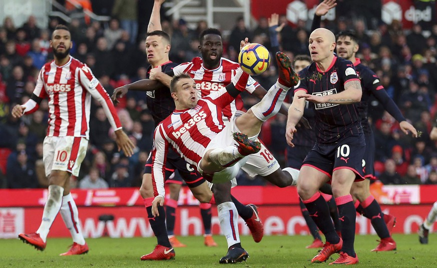 Stoke City's Xherdan Shaqiri has a shot and scores but has his goal against Huddersfield Town is disallowed during their English Premier League soccer match at the bet365 Stadium in Stoke, England, Saturday Jan. 20, 2018. (Nigel French/PA via AP)