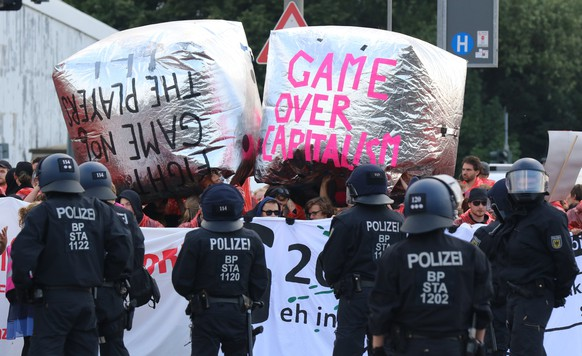 epa06071935 Protesters attend the demonstration at the Hamburg Harbour during the G20 summit in Hamburg, Germany, 07 July 2017. They hold a banner with the inscription 'Game Over Capitalsim'.  The G20 Summit (or G-20 or Group of Twenty) is an international forum for governments from 20 major economies. The summit is taking place in Hamburg from 07 to 08 July 2017.  EPA/FOCKE STRANGMANN