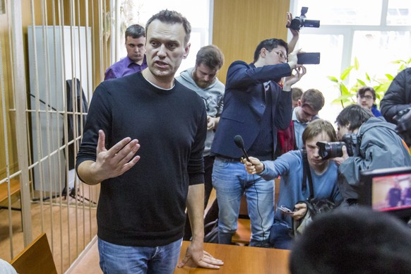 Russian opposition leader Alexei Navalny speaks to press in a court room in Moscow, Russia, Monday, March 27, 2017. Russian opposition leader Alexei Navalny is making a court appearance Monday, a day after being detained at a major opposition rally  on Sunday. (AP Photo/Denis Tyrin)