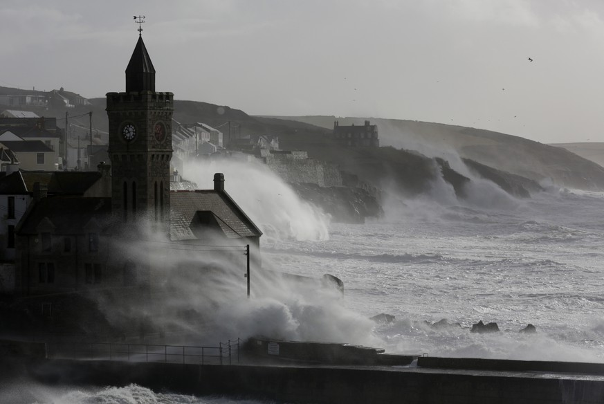 PORTHLEVEN, UNITED KINGDOM - FEBRUARY 08:  High tide storm waves break at Porthleven on February 8, 2014 in Cornwall, England. The UK is bracing itself for more storms and spells of rain over the weekend. (Photo by Matt Cardy/Getty Images)