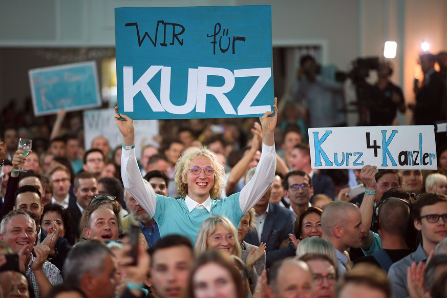 epa07880004 Austrian People's Party (OeVP) and OeVP supporters hold signs reading 'We for Kurz' and  'Kurz for chancellor' at an OeVP election party during the Austrian federal elections in Vienna, Austria, 29 September 2019.  EPA/CHRISTIAN BRUNA