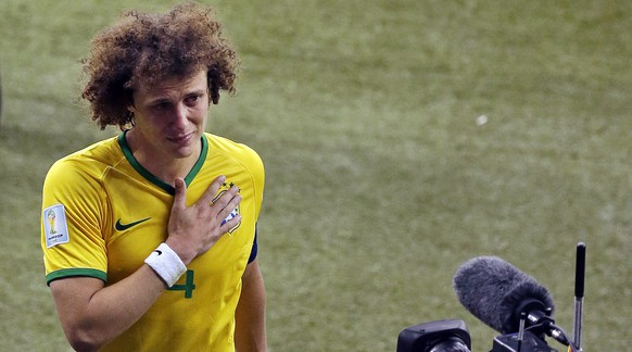 FILE - In this July 8, 2014 file photo, Brazil's David Luiz gestures to the camera as he leaves the pitch after Germany defeated Brazil 7-1 at a World Cup semifinal soccer match in Belo Horizonte, Brazil, Tuesday, July 8, 2014. Watching such a tragedy befall the five-time champion at its home World Cup, and the ensuing Amazon rivers of Brazilian tears, became difficult even for some German fans, who later said they just wanted the torturing of Brazil to stop. (AP Photo/Themba Hadebe, File)