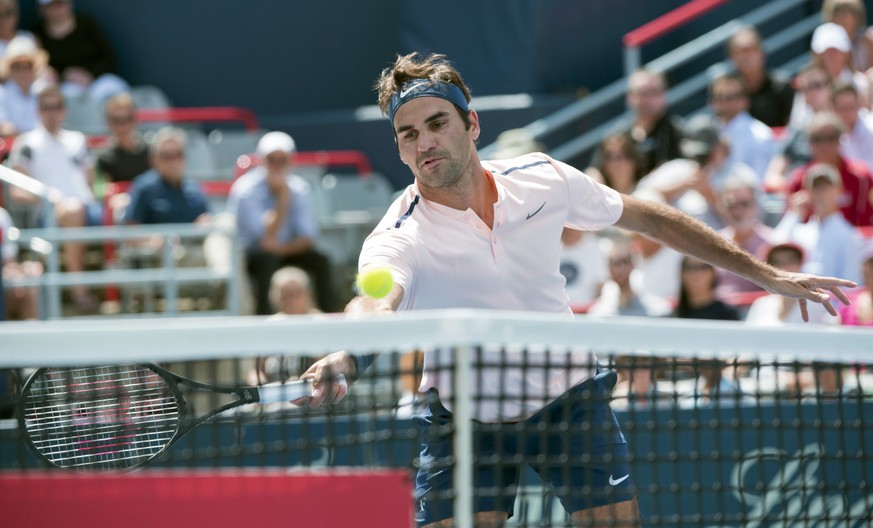 Roger Federer, of Switzerland, goes up to the net as he faces Peter Polansky, of Canada, at the Rogers Cup tennis tournament, Wednesday, Aug. 9, 2017 in Montreal. (Paul Chiasson/The Canadian Press via AP)