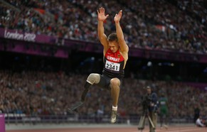 FILE In this Friday, Aug. 31, 2012 file photo Germany's Markus Rehm makes a world record jump of 7.14 meters in the men's long jump F42/44 final during the athletics competition at the 2012 Paralympics, in London. The German athletics federation has excluded an amputee long jumper from its squad for the upcoming European Championship, saying his carbon-fiber prosthesis gives him an unfair advantage it was reported Wednesday July 30, 2014. Paralympics champion Markus Rehm won the long jump competition at the German nationals last weekend with an effort of 8.24 meters. (AP Photo/Matt Dunham, File)