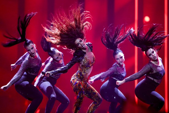 epaselect epa06720506 Eleni Foureira (C) representing Cyprus with 'Fuego' performs during the First Semi-Final of the 63rd annual Eurovision Song Contest (ESC) at the Altice Arena in Lisbon, Portugal, 08 May 2018. The Second Semi-Final of the ESC 2018 will take place on 10 May, and the Grand Final is held on 12 May.  EPA/JOSE SENA GOULAO *** Local Caption *** 50359766
