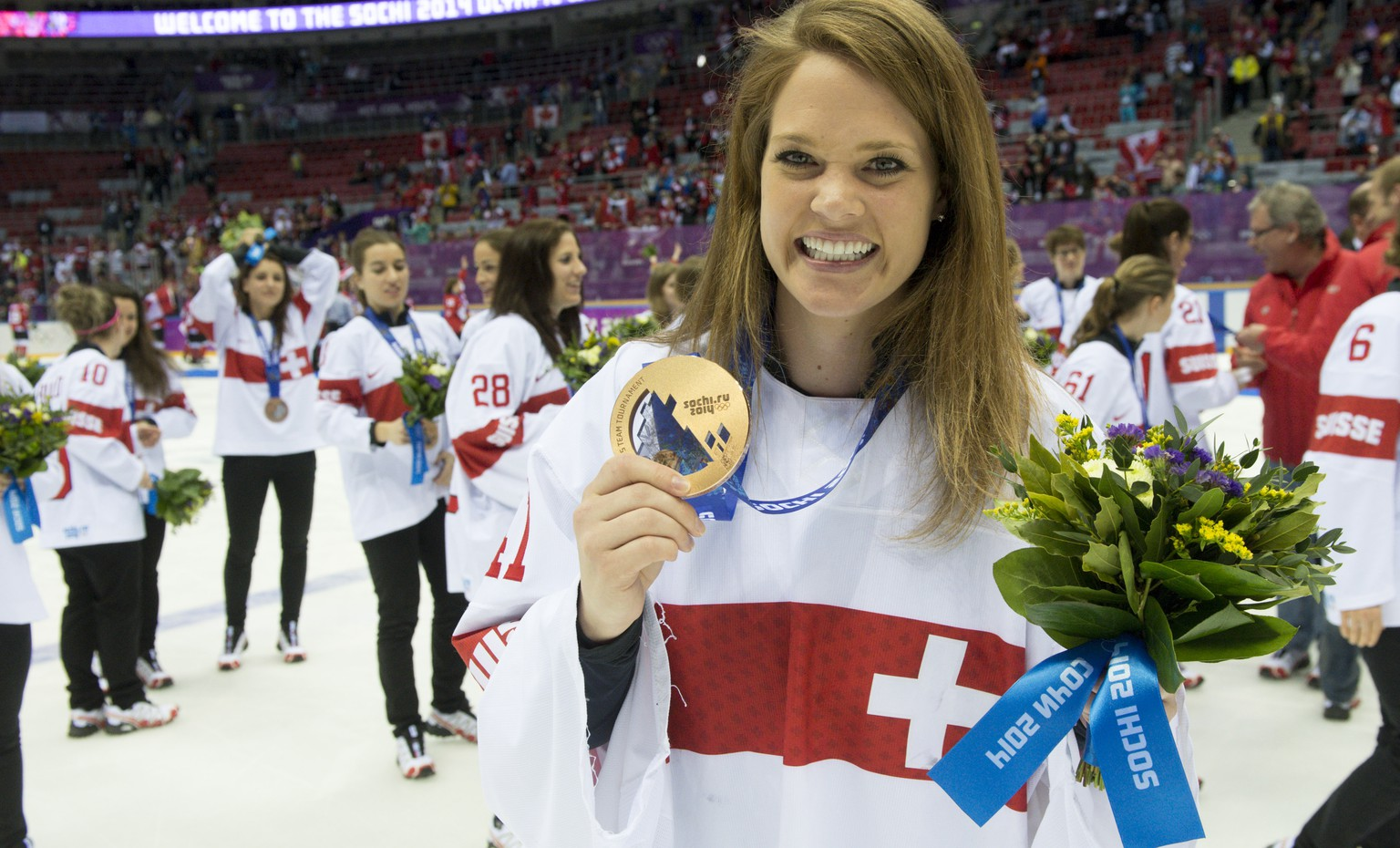 Switzerland's ice hockey women goalkeeper Florence Schelling celebrates her bronze medal during the women's ice hockey victory ceremony at the XXII Winter Olympics 2014 Sochi, at the Bolshoy Ice Dome, in Sochi, Russia, on Thursday, February 20, 2014. (KEYSTONE/Laurent Gillieron)