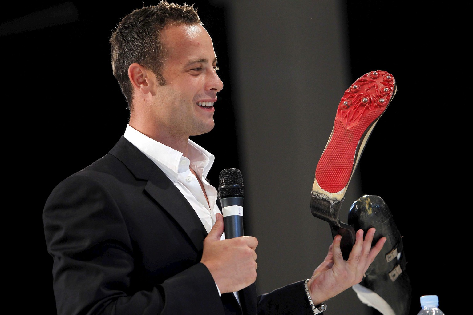 epa04088060 (FILE) A file picture dated 10 March 2011 shows South African Paralympic runner Oscar Pistorius showing one of his artificial lower limbs as he takes part in a round table session during the 3rd Global Sports Forum in Barcelona, Spain. Pistorius is due to stand trial from 03 March for the premeditated murder of his model girlfriend Reeva Steenkamp in February 2013.  EPA/MARTA PEREZ *** Local Caption *** 02625453