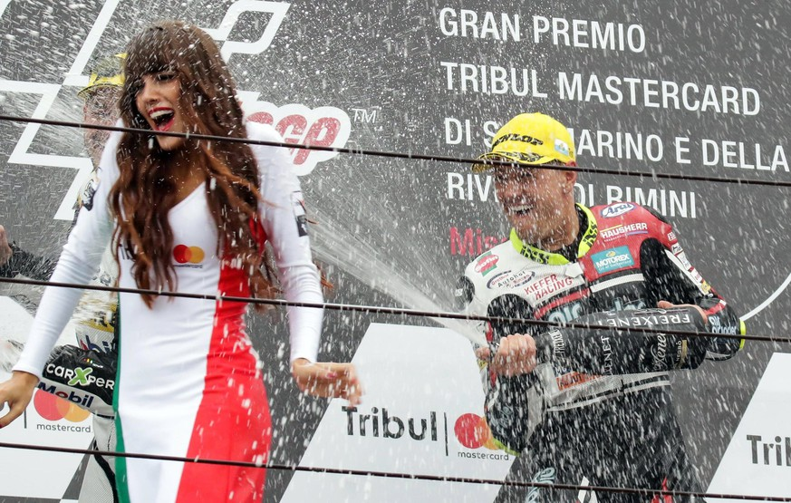 epa06196236 Swiss rider Dominique Aegerter of Kiefer Racing celebrates on the podium after winning the Moto2 Grand Prix of San Marino and Riviera of Rimini at Misano circuit, in Misano Adriatico, Italy, 10 September 2017.  EPA/Fabrizio Petrangeli