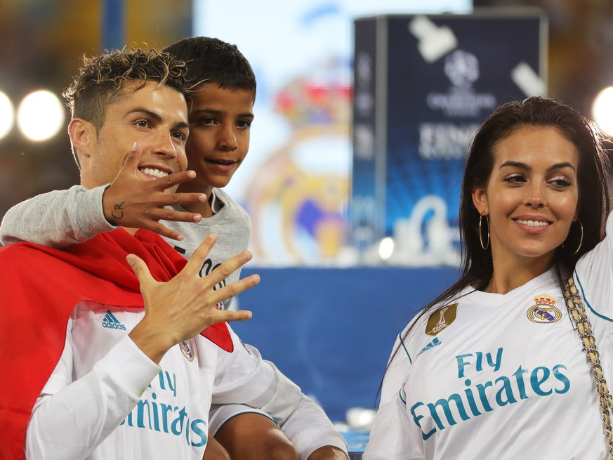 epa06765905 Cristiano Ronaldo of Real Madrid and his son Cristiano Ronaldo Jr. and girlfriend Georgina Rodriguez celebrate after the UEFA Champions League final between Real Madrid and Liverpool FC at the NSC Olimpiyskiy stadium in Kiev, Ukraine, 26 May 2018. Madrid won 3-1.  EPA/ARMANDO BABANI