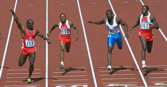 Canadian sprinter Ben Johnson, left, looks over at rival Carl Lewis at the finish of the 100-meter race in Seoul, Korea, Saturday, Sept. 24, 1988.  Runners are from left: Johnson, Calvin Smith, U.S.; Linford Christie, Great Britain and Lewis, U.S.  Olympic officials later stripped Johnson of his gold medal and world record at the games in Seoul, after he tested positive for steroids. Johnson was banned from competition for life.  (AP Photo/Ira Gostin)