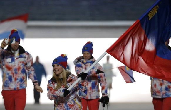 Liechtenstein's flag-bearer Tina Weirather leads her country's contingent during the athletes' parade at the opening ceremony of the 2014 Sochi Winter Olympics, February 7, 2014.      REUTERS/Phil Noble (RUSSIA  - Tags: OLYMPICS SPORT)