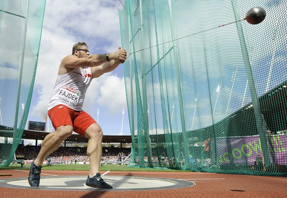 Poland's Pawel Fajdek makes an attempt in the men's hammer throw final during the European Athletics Championships in Zurich, Switzerland, Saturday, Aug. 16, 2014. (AP Photo/Martin Meissner)