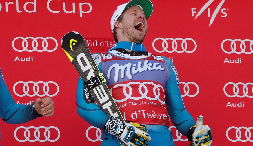 Alpine Skiing - FIS Alpine Skiing World Cup - Men's Super G - Val d'Isere, France - 2/12/16.  Kjetil Jansrud (R) and Aksel Lund Svindal of Norway celebrate on the podium. REUTERS/Christian Hartmann
