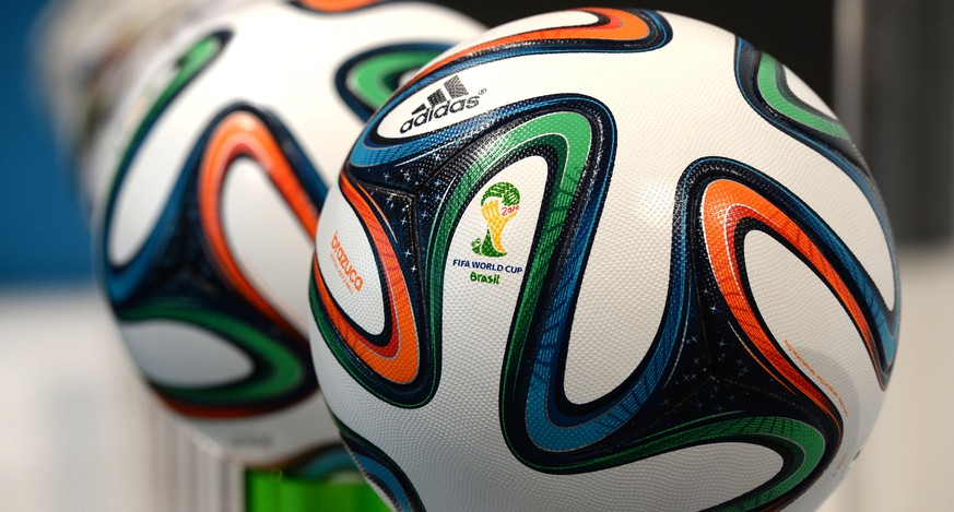 "(FILES) - Picture taken on May 8, 2014 shows the Adidas official FIFA World Cup 2014 ball ""Brazuca"" as it is presented during the company's shareholders' meeting in Fuerth, southern Germany. Greenpeace criticized the use of toxic chemicals by Adidas in their products on May 8, 2014. AFP PHOTO/CHRISTOF STACHE"