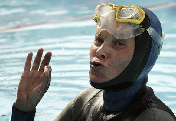 FILE - In this Friday, Aug. 26, 2005 file photo, Natalia Molchanova of Russia reacts after she set a new world record, holding her breath underwater for  7 minutes and 16 seconds, at the first Individual World Freediving Championship in Pool, in Renens near Lausanne, Switzerland. The search for free-diving great Natalia Molchanova was set to resume Wednesday Aug. 5, 2015 with little hope remaining she would be found alive more than two days after disappearing off Spain's Balearic islands. Molchanova was among the most decorated competitors in free-diving, a sport in which participants swim as deeply as they can while holding their breath. (Fabrice Coffrini/Keystone via AP, file)
