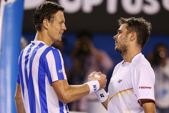 MELBOURNE, AUSTRALIA - JANUARY 23:  Stanislas Wawrinka (R) of Switzerland shakes hands after winning his semifinal match against Tomas Berdych of the Czech Republic during day 11 of the 2014 Australian Open at Melbourne Park on January 23, 2014 in Melbourne, Australia.  (Photo by Michael Dodge/Getty Images)