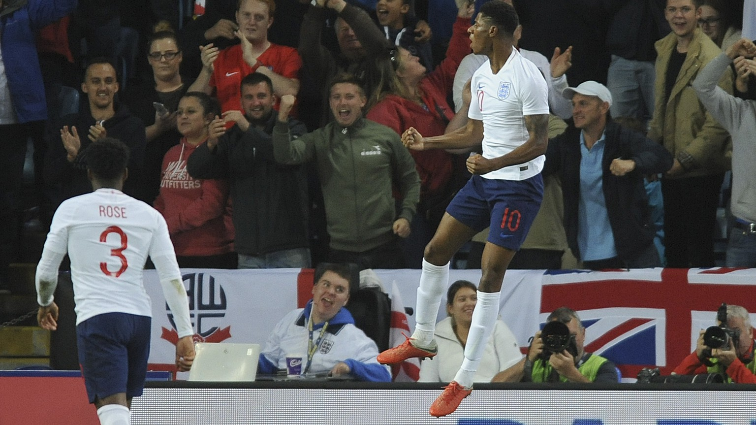 England's Marcus Rashford celebrates after scoring his side's first goal during the International friendly soccer match between England and Switzerland at the King Power Stadium in Leicester, England, Tuesday, Sept. 11, 2018 . (AP Photo/ Rui Vieira)
