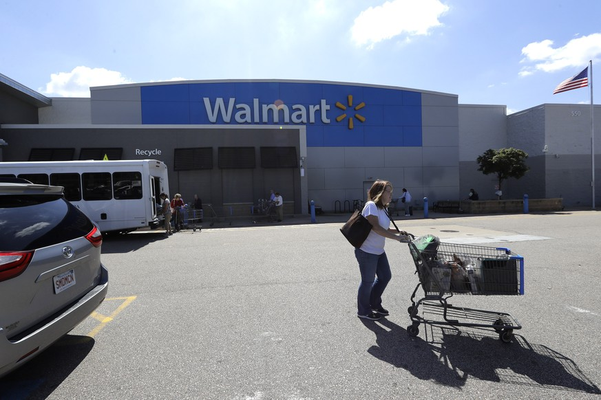 A customer pushes a shopping cart Tuesday, Sept. 3, 2019, outside a Walmart store, in Walpole, Mass. Walmart is going back to its folksy hunting heritage and getting rid of anything that's not related to a hunting rifle after two mass shootings in its stores in one week left 24 people dead in August of 2019. (AP Photo/Steven Senne) Bernie Sanders
