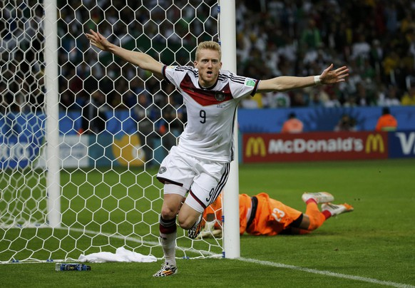 Germany's Andre Schuerrle celebrates his goal against Algeria during extra time in their 2014 World Cup round of 16 game at the Beira Rio stadium in Porto Alegre June 30, 2014.  REUTERS/Edgard Garrido (BRAZIL  - Tags: SOCCER SPORT WORLD CUP TPX IMAGES OF THE DAY)       TOPCUP