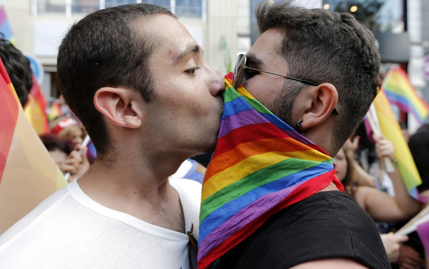 epa04289581 Two men kiss as they participate in the 12th annual Gay Pride Parade in Istanbul, Turkey, 29 June 2014. The event ended the annual Pride Week that started on 22 June with the Trans Pride march. Hundreds of LGBT (Lesbian, Gay, Bisexual, Transexual) people walked through downtown Istanbul to support rights for sexual minorities.  EPA/SEDAT SUNA