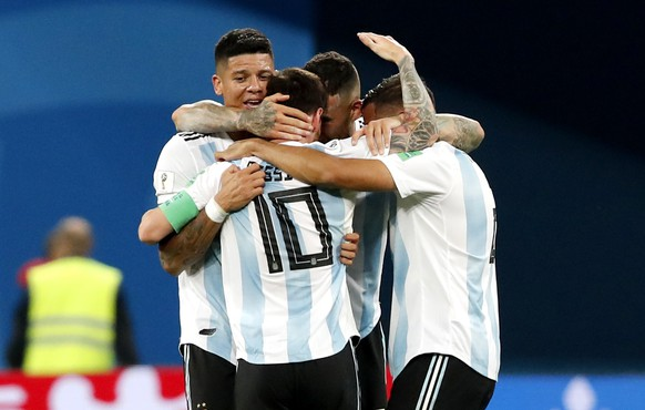 epa06842861 Lionel Messi of Argentina (C, front) celebrates with teammates during the FIFA World Cup 2018 group D preliminary round soccer match between Nigeria and Argentina in St.Petersburg, Russia, 26 June 2018.  (RESTRICTIONS APPLY: Editorial Use Only, not used in association with any commercial entity - Images must not be used in any form of alert service or push service of any kind including via mobile alert services, downloads to mobile devices or MMS messaging - Images must appear as still images and must not emulate match action video footage - No alteration is made to, and no text or image is superimposed over, any published image which: (a) intentionally obscures or removes a sponsor identification image; or (b) adds or overlays the commercial identification of any third party which is not officially associated with the FIFA World Cup)  EPA/ANATOLY MALTSEV EDITORIAL USE ONLY  EDITORIAL USE ONLY