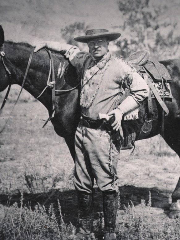 This 1884 photo provided by the Theodore Roosevelt Center shows Theodore Roosevelt standing with a saddled horse in the Badlands of Dakota Territory. Roosevelt originally came to what is now North Dakota is hopes of killing a buffalo. The former president stayed after becoming enamored with the rugged, beautiful territory of the badlands. The Theodore Roosevelt Center at Dickinson State University in North Dakota has been archiving notes, letters and photographs of Roosevelt since 2007 and is working to open his presidential library by 2019. (AP Photo/Courtesy of the Theodore Roosevelt Center/Theodore Roosevelt Birthplace National Site)
