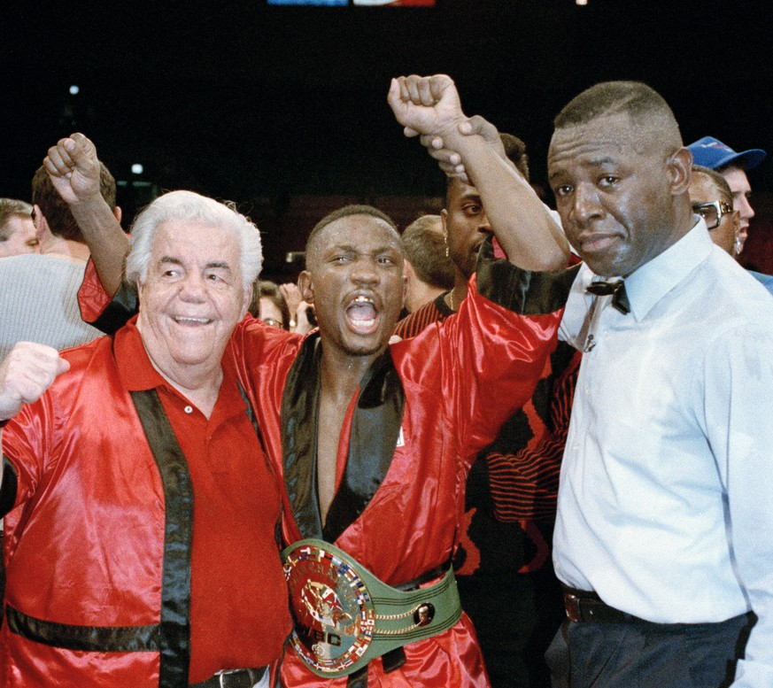 FILE - In this March 6, 1993, file photo, Pernell Whitaker celebrates after winning his third world championship with a unanimous decision over James