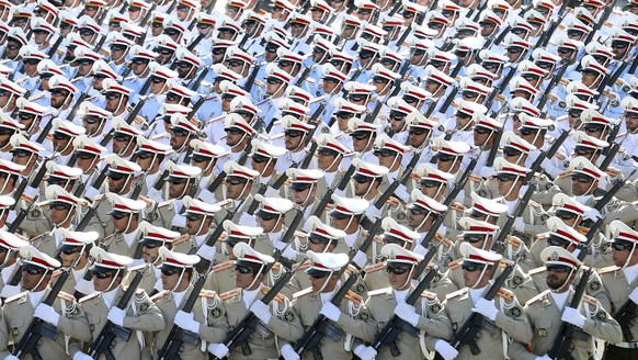 FILE -- In this Sept. 21, 2016 file photo, Iranian armed forces members march in a military parade marking the 36th anniversary of Iraq's 1980 invasion of Iran, just outside Tehran, Iran. Iranian President Hassan Rouhani has seen his influence wane as his signature achievement, the nuclear deal with world powers, is now under threat from President Donald Trump. Economic problems, as well as some suggesting a military dictatorship for the country, suggest Iran's domestic politics may swing back toward hard-liners and further weaken the once-popular president. (AP Photo/Ebrahim Noroozi, File)