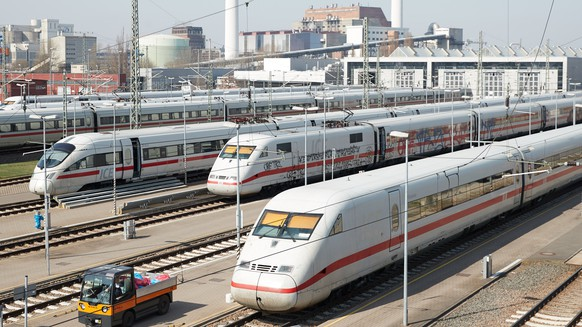 epa06659126 ICE trains of various generations are parked outside of the new vehicle hall at the Riemelsburg ICE plant in Berlin, Germany, 10 April 2018. Since the opening of the new train hall in 2016 at the Berlin-Rummelsburg operating station, the German railway company 'Deutsche Bahn' (DB) has modernized the ICE plant further with resource-saving solutions and extended the tracks for the long-distance Intercity-Express high-speed trains of the 'ICE 4' generation.  EPA/HAYOUNG JEON