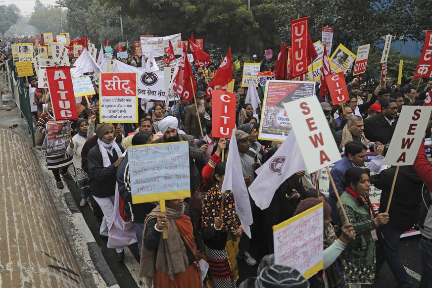 Trade union members march during a general strike called by various trade unions, in New Delhi, India, Wednesday, Jan. 8, 2020. Trade unions have called for a country-wide strike Wednesday to protest against what they call the