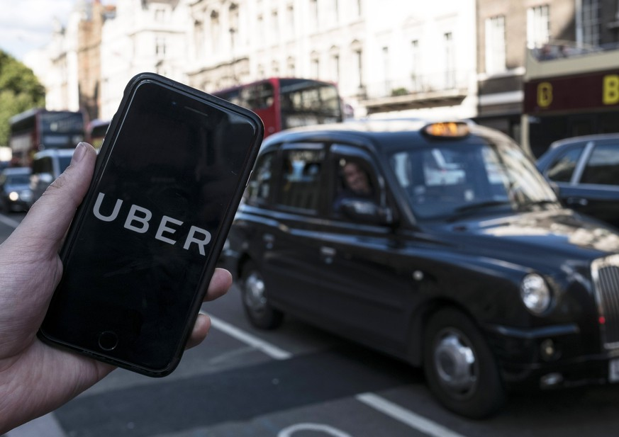 epa06355410 (FILE) - An image showing an Uber app on a mobile phone in central London, Britain, 22 September 2017. Media reports on 28 November 2017 state Japanese Softbank corporation may be close to offering Uber's existing shareholders to buy their shares in Uber for a valuation of some 48 billion USD, meaning the shareholders would be paid some 30 per cent less per share than what was paid when Uber raised funds for the last time.  EPA/WILL OLIVER