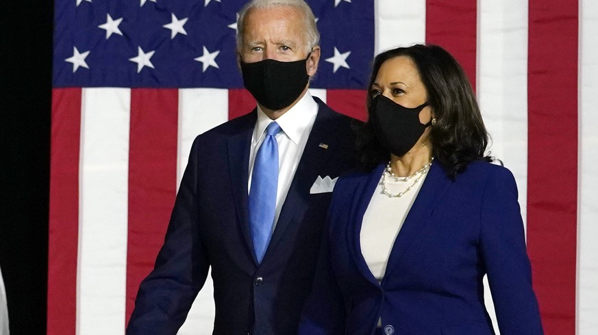 Democratic presidential candidate former Vice President Joe Biden and his running mate Sen. Kamala Harris, D-Calif., arrive to speak at a news conference at Alexis Dupont High School in Wilmington, Del., Wednesday, Aug. 12, 2020. (AP Photo/Carolyn Kaster) Joe Biden,Kamala Harris