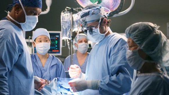 In this undated publicity photo released by ABC, actors James Pickens, Jr., left, Sandra Oh, center, and Patrick Dempsey, second from right, appear in this scene from the television series