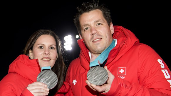 Jenny Perret, left, and Martin Rios, right, of Switzerland pose with their silver medals at the House of Switzerland after the victory ceremony of the curling mixed doubles at the XXIII Winter Olympics 2018 in Pyeongchang, South Korea, on Wednesday, February 14, 2018. (KEYSTONE/Jean-Christophe Bott)