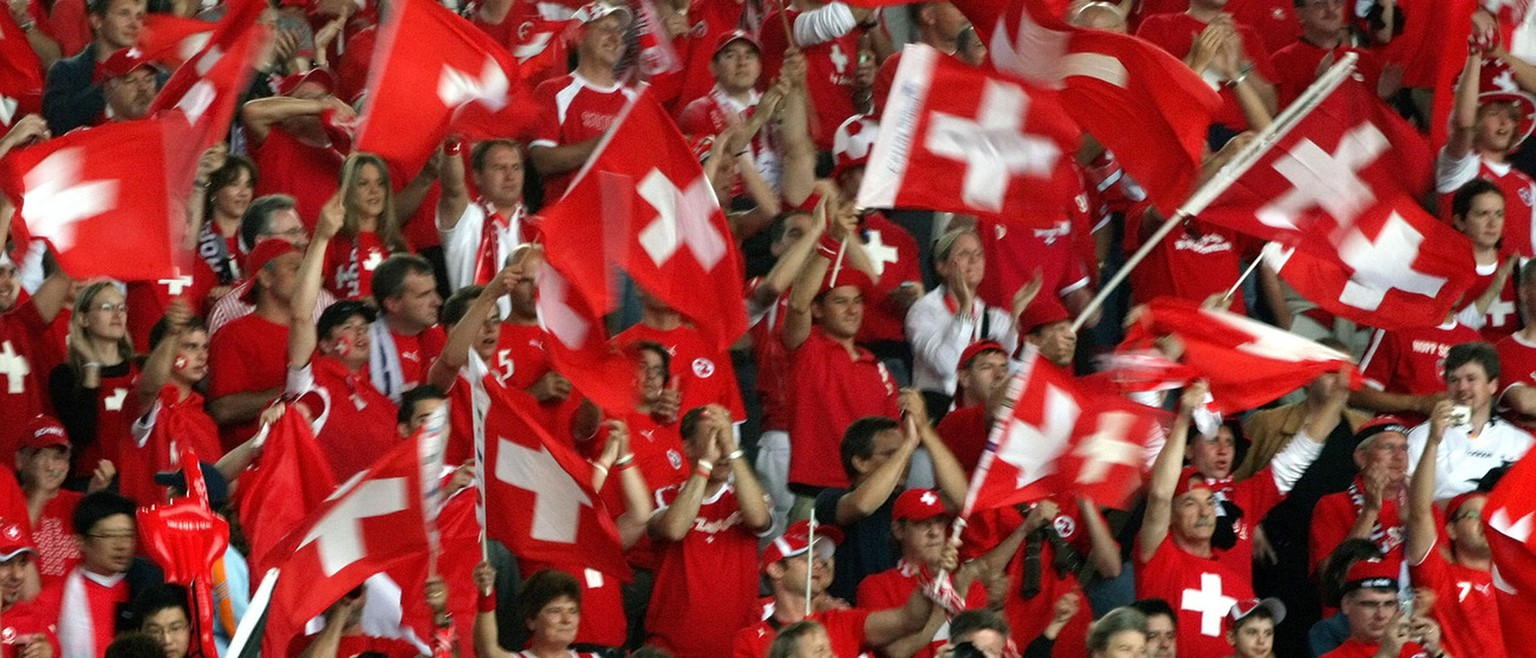 Swiss soccer fans wave flags before the start of the  Switzerland v. South Korea 2006 World Cup Group E soccer match at the World Cup stadium, Friday, June 23, 2006, in Hanover, Germany. France and Togo also play in Group G.  (AP Photo/Dusan Vranic) ** MOBILE/PDA USAGE OUT **30553770@30306882